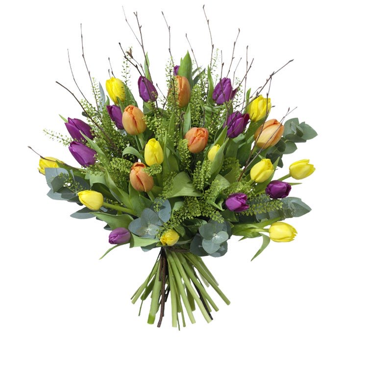 Påskbukett med tulpaner i blandade färger tillsammans med björkris (eller liknande). Skicka blomsterbud via Interflora!