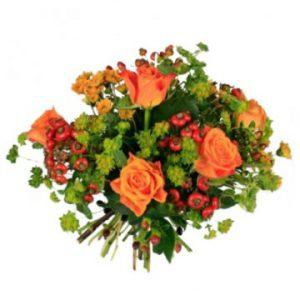 Blombukett med blommor i orange höstfärger. Skicka blommorna med bud från Florister i Sverige.